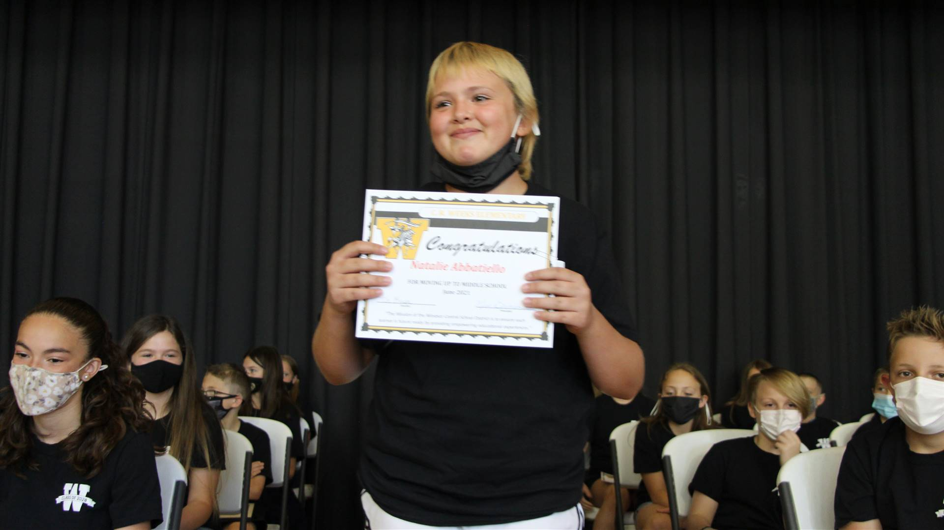 Young student holding a certificate