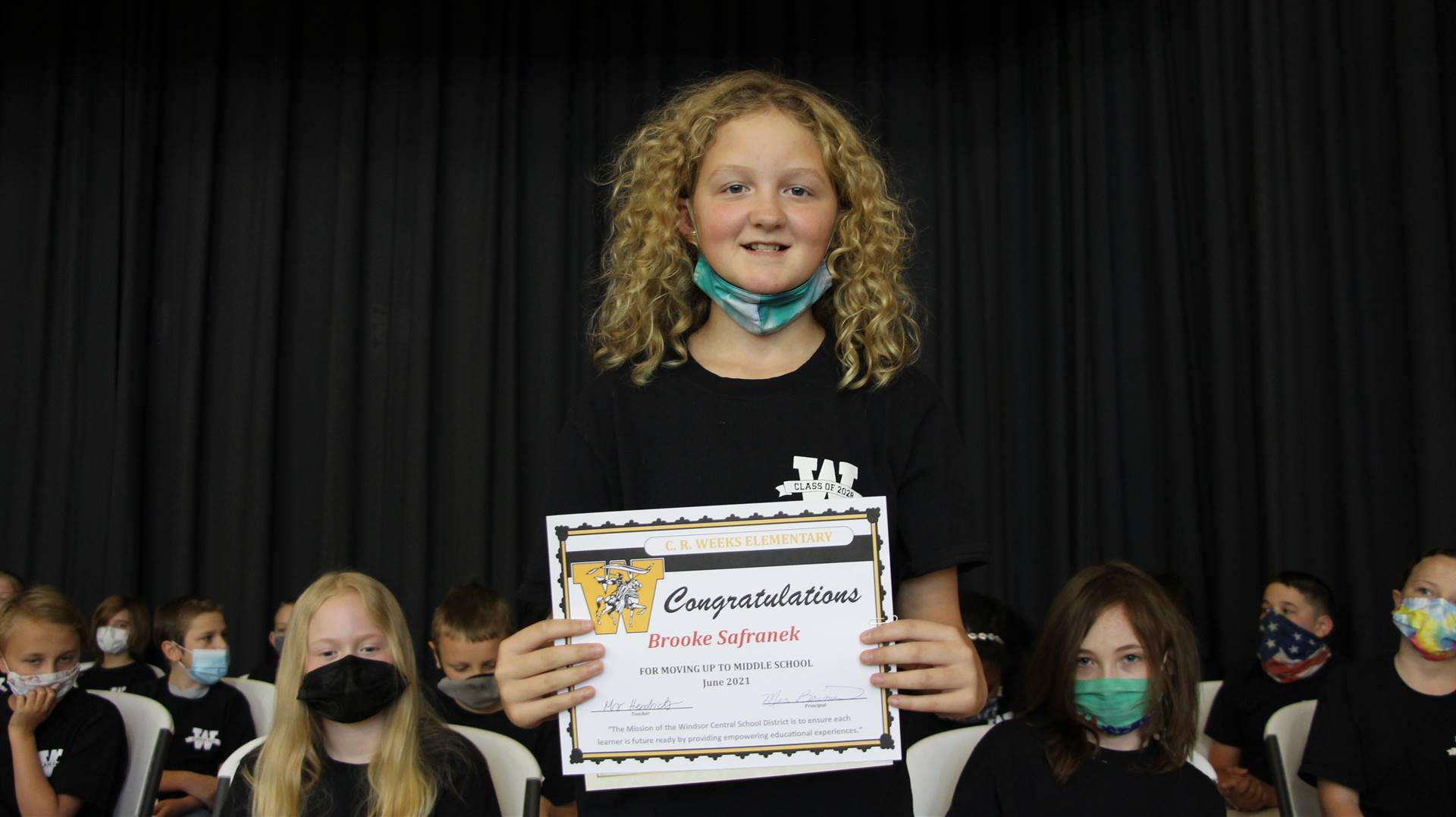Young girl holding a certificate